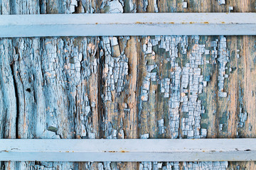 Cracked plywood with an old blue paint