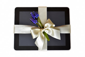 Digital tablet with white ribbon isolated on white background