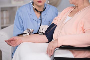 Disabled woman having measured pressure