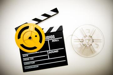 Movie clapper board and super 8 mm reels vintage color effect
