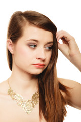Portrait of girl with golden necklace isolated