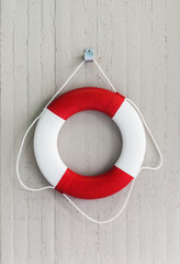 Red life buoy hanging on a wall. Danger and risk concept