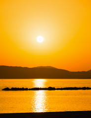 orange sunset in Alghero shore