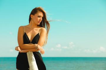 Beautiful girl on beach, summertime