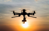 Drone flying in the sunset