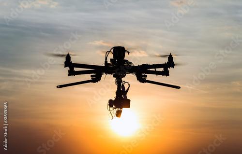 Leinwanddruck Bild Drone flying in the sunset
