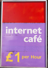 Sign for 'Internet cafe' £1 per hour isolated