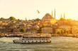 Leinwanddruck Bild - Tourist boat floats on the Golden Horn in Istanbul