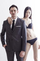 Businessman portrait with sexy chinese model