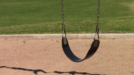 An empty swing  in a playground in Mesa Arizona