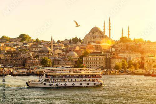 Leinwanddruck Bild Tourist boat floats on the Golden Horn in Istanbul
