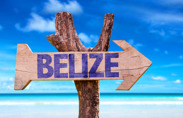 Belize wooden sign with beach background