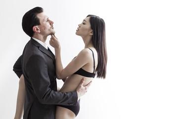 Beautiful chinese model flirting with businessman