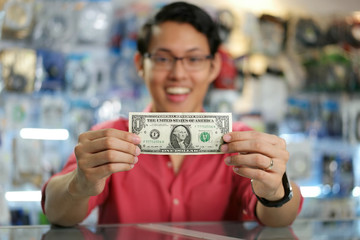 Happy Chinese Man Showing First Dollar Earning In Computer Shop