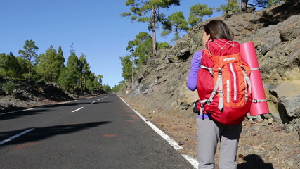Hitchhiking woman backpacker hitchhiker