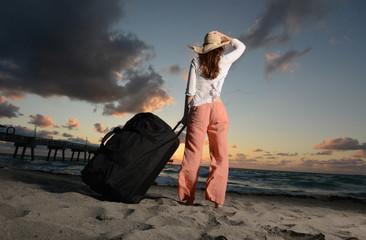 Single woman on vacation at beach