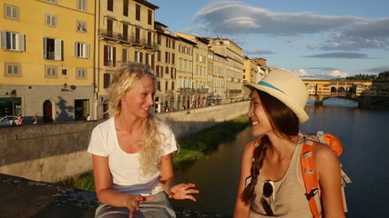 Women girlfriends talking on travel in Florence