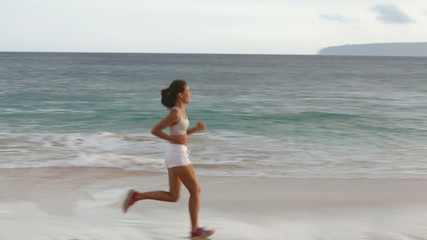 Running woman healthy lifestyle jogging on beach