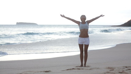 Free woman enjoying freedom feeling happy at beach