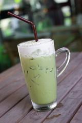 Glass of iced green tea latte.