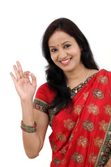 Happy traditional Indian woman making ok gesture