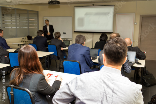 business people group at meeting seminar presentation - 81643683