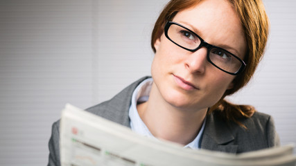 Business Woman with Newspaper