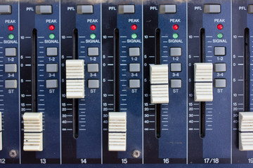 Audio sound mixer with buttons and sliders.
