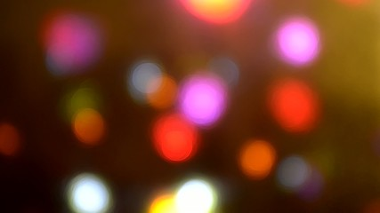 Close-up at colorful moving disco lights