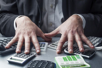 male business hands with calculators