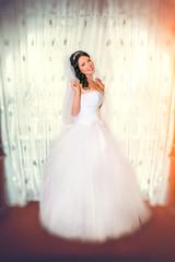 Slim beautiful woman wearing luxurious wedding dress