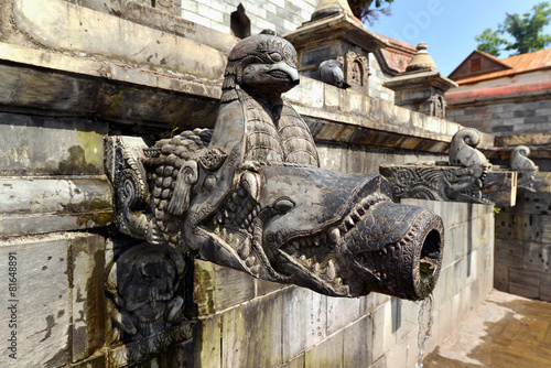 Poster Carved stone public fountain in Pashupatinath, Nepal