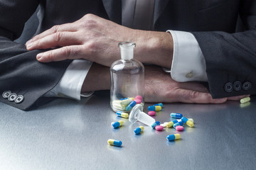 businessman taking pills and drugs for facing work schedules