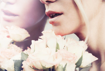 close up sensual woman's lips in pastel color with bouquet of ro