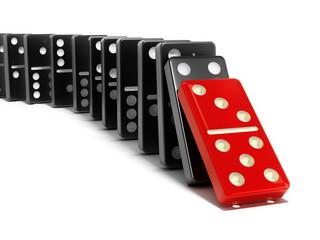 Red domino tile falling towards the black tiles