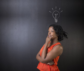 Bright idea lightbulb thinking African American woman teacher