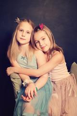 Little sisters girls hugging