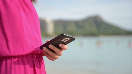 Woman in Fuchsia Dress Holding Mobile Phone