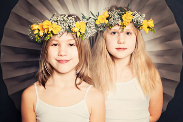 Smiling sisters, portrait with flowers