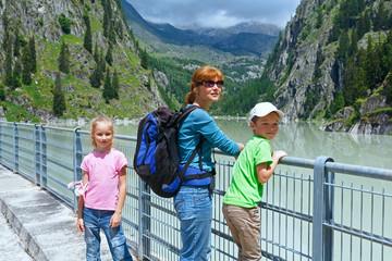 Family on dam ( Switzerland)
