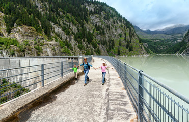 Family near dam ( Switzerland)