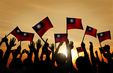 Group of People Taiwanese Flags in Back Lit Concept