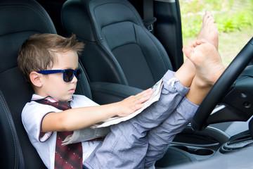 Cute driver reads newspaper in car