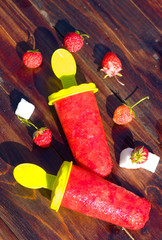 Strawberry homemade Popsicles with berries outdore