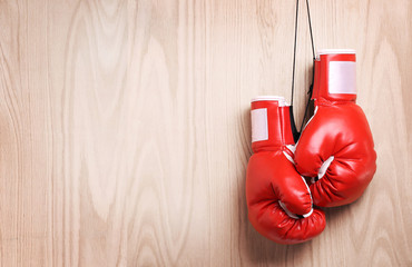 Boxing gloves over wooden background