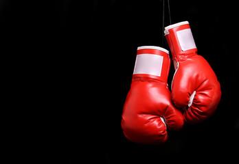 Boxing gloves over black backround