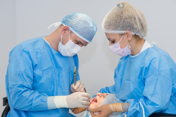 Dentists during surgery for implant placement