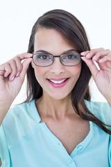 Pretty woman holding her eyeglasses