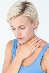 Pretty woman suffering from throat pain
