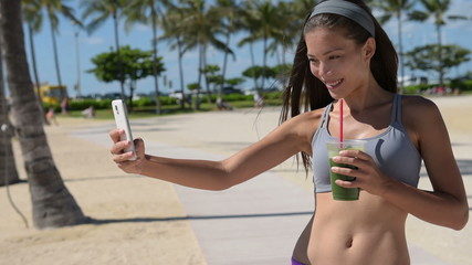 Fit Woman with Healthy Green Juice Taking Selfie
